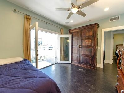 Room 2 with twin bed and 1 Queen Murphy bed; private access to patio