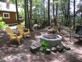 Tunk Lake cabin photo - Fire pit in back yard.