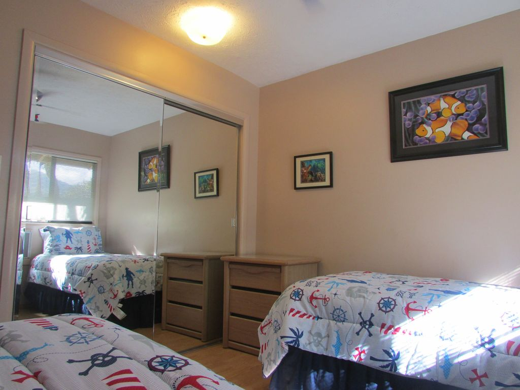 Kids room with two twin beds and fun furnishings.
