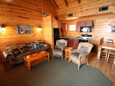 Lake Texoma cottage rental - Great room of 2-bedrm-plus-loft lakefront unit w/fireplace,dishwasher & jacuzzi