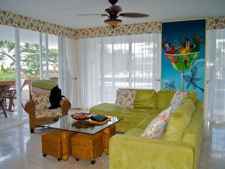 Cozumel condo photo - bright and airy living room