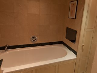 Ensuite bathroom - large bath with built in TV and speakers