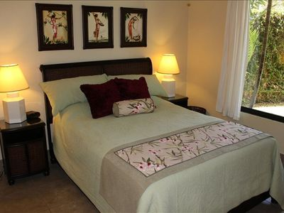 Pier 1 furnishings in the bright master suite with queen-sized bed...