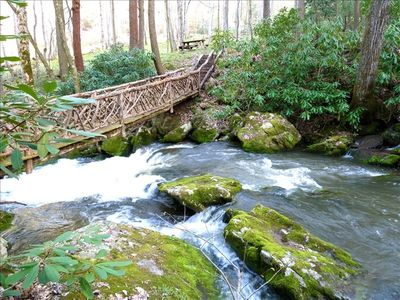 Walking bridge and white water creek at Winding Falls