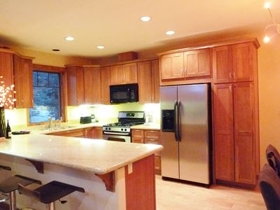 Large Fully Equipped Gourmet Kitchen with Granite Bar & Stainless Appliances