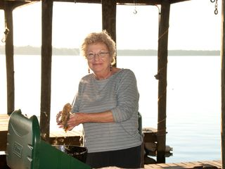 Fruitland house photo - Miss Pauline fries up some fish in the boat house.