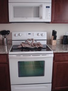Fully equipped Kitchen with microwave, glass top stove & many small appliances