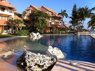 Puerto Aventuras condo photo - Our pool - the perfect place to relax