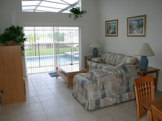 Emerald Island villa photo - Family room overlooking and with access to pool.