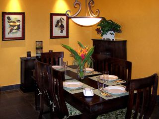 Playa Langosta condo photo - The Indonesian dining room is equipped for fine dining or for barefoot snacks.