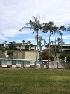 The view from our living room and back patio, features the pool and bayview.