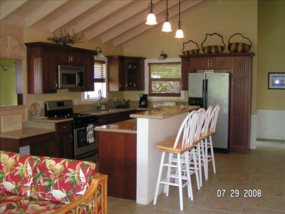 Kitchen with Cherry Cabinets, Open Beams, Tile Floors