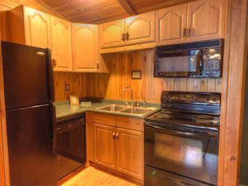 Fully-equipped kitchen of 2-bedroom, lakefront cottage w/fireplace & jacuzzi tub