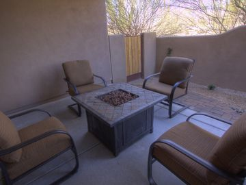 Backyard patio has cozy firepit and large side yard to relax in the sun.