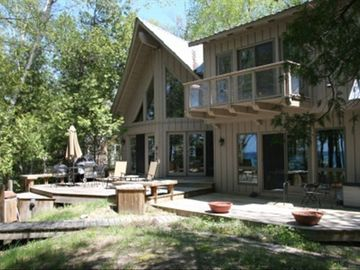 Large deck allows room for dining as well as enjoying the lake views and breezes