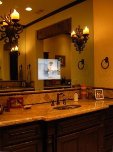 Master Suite offeres make up counter, bar, his & her's vanities with built in TV