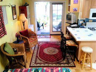Our Cottage sitting area with tiled dining/writing table