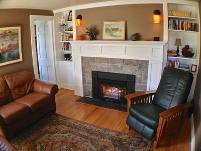 The cozy library with stone gas fireplace & comfy seating--perfect for relaxing.