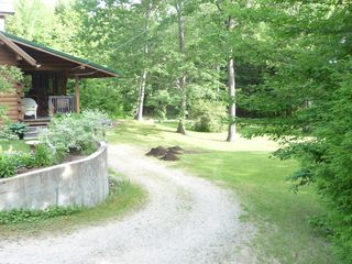 Long winding driveway off Shore Rd, Cabin is nestled on 6 private acres - Kennebunk house vacation rental photo