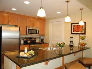 Winter Park condo photo - Gourmet kitchen with large granite counter, perfect place to entertain.