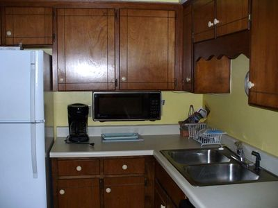Your fully equipped kitchen w/ washer/dryer adjoining.