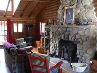 Malone cabin photo - Don't you deserve to relax at night by the fire?