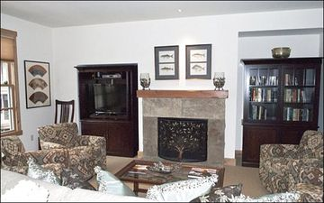 Flat-Screen TV and Fireplace in the Living Room