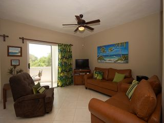 Playacar condo photo - Spacious living room adjacent to the terrace.