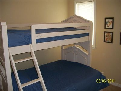 Full and upper single bunk bed in the children's bedroom