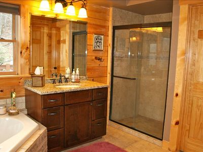 Master Bathroom with walk in shower, jacuzzi tub, and 2 sinks.