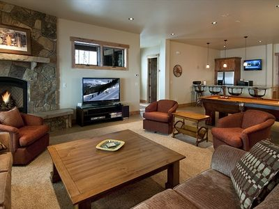 "Downstairs family room with 52"" LCD TV, full pool table, and wet bar/refrig"