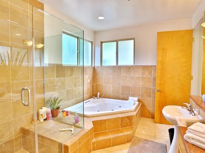 Gorgeous Maser Bathroom w/ large separate shower and jacuzzi tub.