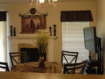 Branson condo rental - Living and Dining area, featuring a 43-inch flat screen TV , DVD player, Wi-Fi.