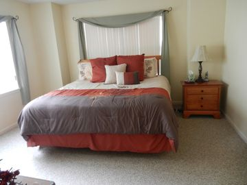 Guestbedroom with king sized bed, flat screen tv