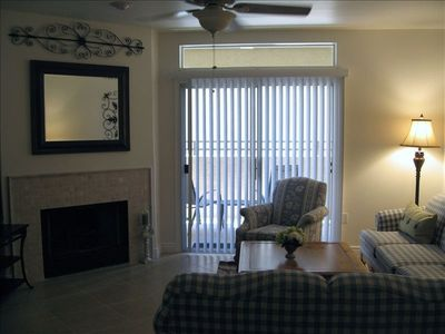 Living room with flat screen tv, slider to patio. Seating for 6.