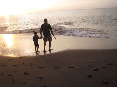 My husband and son near sunset on our Woodlands Beach.