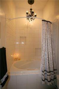 Bathroom has extra large soaking tub complete with chandelier! Bliss.