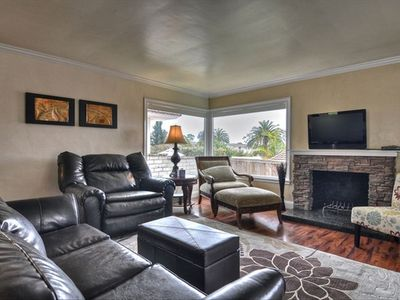 Lovely family room with fireplace and hardwood floors.