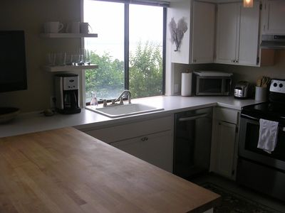 Garden Level Unit: Remodeled kitchen with all the cooking amenities you need!