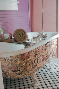 The shell mosaic on the clawfoot tub is the inspiration for the bath colors