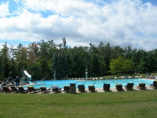 Poconos Pines - Pinecrest Lake townhome photo - olympic size heated swimming pool