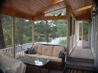 New screened porch with furniture. The porch has 4 skylights with cedar ceiling - Alexandria Bay cottage vacation rental photo