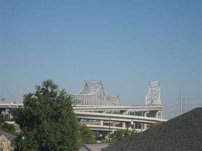 VIEW OF CRECENT CITY BRIDGE OVER MISSISSIPPI RIVER FROM DORMER WINDOW