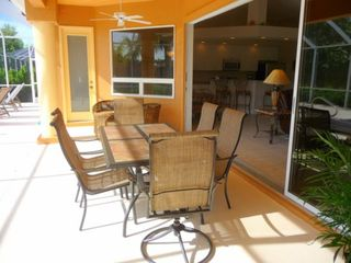 Cape Coral house photo - Pool side lanai opens to include great room and kitchen