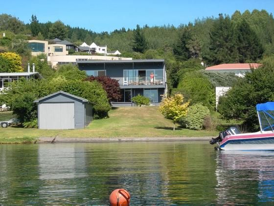 Unique waterfront bach 913 acacia bay road vrbo for Minimalist house lake taupo