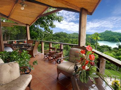 Manuel Antonio villa rental - Upper balcony furnished for living and outdoor dining. Electric grill included!