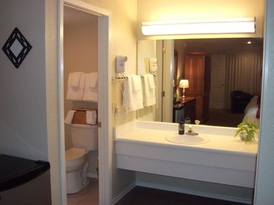 Third guest bedroom bath, all bathrooms have a hair dryer