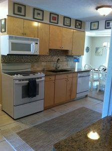 View of upgraded kitchen (granite, wine fridge!)