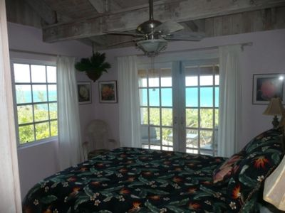 Sunset Guest Bedroom has a 2 way viw of the ocean and entry to patio.