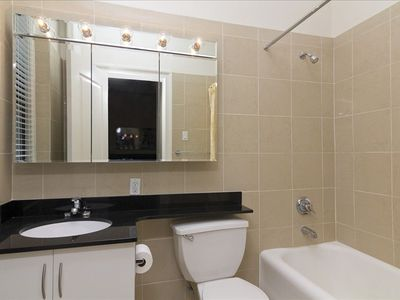 Full bathroom with bathtub, shower and medicine cabinet